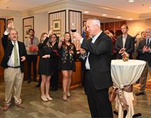 Attendees toast 60th anniversary of LIttle Dinner Series.